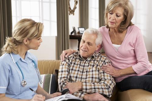 elderly-couple-with-nurse-writing-notes